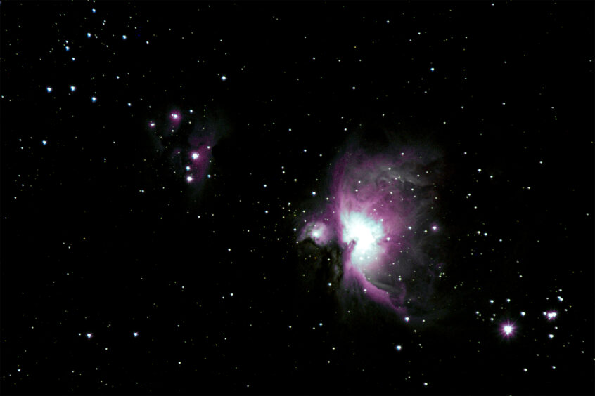 Mike Jensen photographs The Orion Nebula. All rights restricted on this image. Use only by permission of the maker.